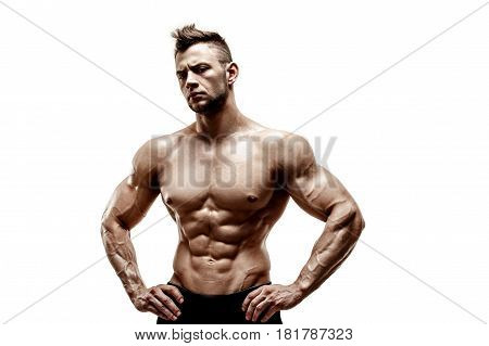 muscular super-high level handsome man with naked torso posing on white background