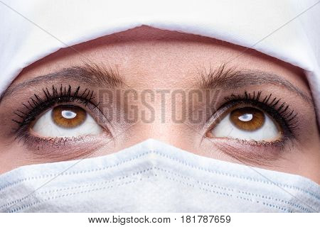Close-up of female doctor wearing surgical cap and mask