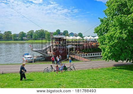 Ferry At Embankment Of Visla River Krakow