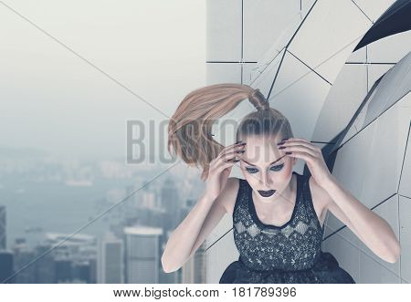 Serious fashion model posing on skyscraper rooftop
