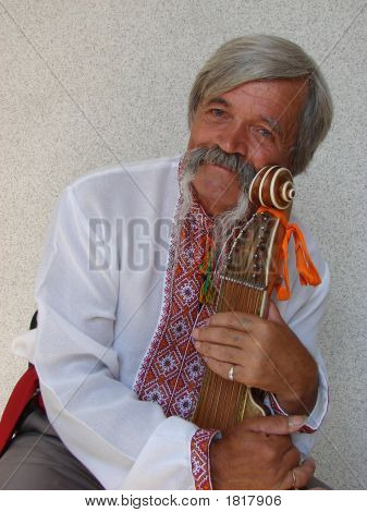 Senior ukrainian folk travelling musician bandurist named Kobzar with instrument bandura poster