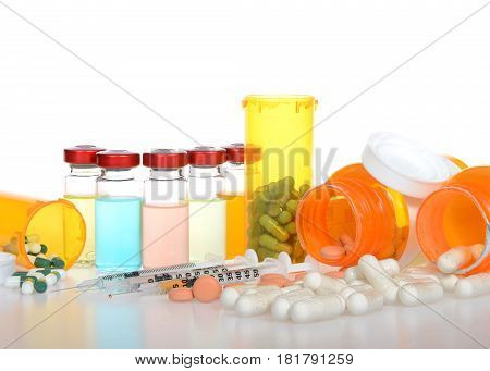 Five vials of medication exaggerated psychedelic with bright color of fluid. Three syringes with drugs and pill bottles spilled on reflective surface white background. Drug addiction treatment cure