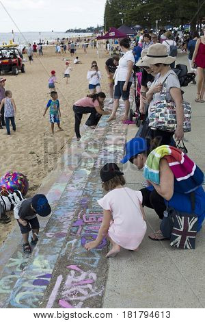 REDCLIFFE, AUSTRALIA - APRIL 14, 2017: Kids painting on the stairs of Suttons Beach during the Redcliffe Festival of Sails an annual event which takes place on Good Friday