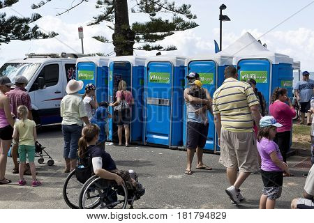 REDCLIFFE, AUSTRALIA - APRIL 14, 2017: Row of public loos on Suttons Beach during the Redcliffe Festival of Sails an annual event which takes place on Good Friday