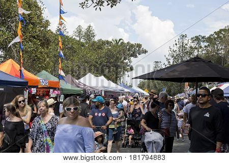 REDCLIFFE, AUSTRALIA - APRIL 14, 2017: Crowds converged into Suttons Beach during the Redcliffe Festival of Sails an annual event which takes place on Good Friday