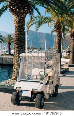 Golf cart in the territory of Porto Montenegro, Tivat, Montenegro. Golf machine, electric car.