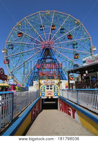 BROOKLYN, NEW YORK - APRIL 13, 2017: Wonder Wheel at the Coney Island amusement park. Deno's Wonder Wheel a hundred and fifty foot eccentric Ferris wheel. This wheel was built in 1920