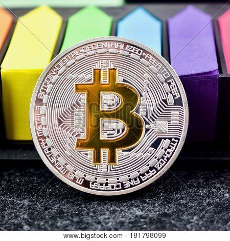 Colorful Arrows And Bitcoin Silver Coin