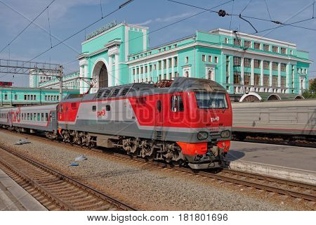 NOVOSIBIRSK, RUSSIA - AUGUST 25, 2014: Passenger train arriving on the main railroad station of Novosibirsk. The building completed in 1939 and can accommodate up to 3.9 thousand passengers