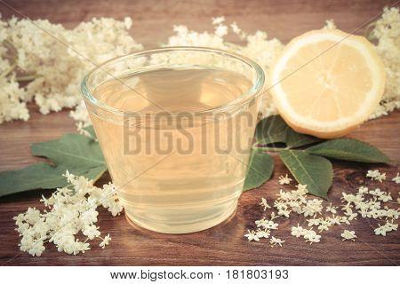 Vintage Photo, Fresh Healthy Juice, Elderberry Flowers And Lemon On Rustic Board