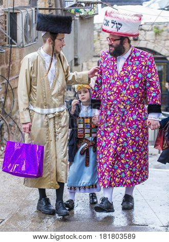 JERUSALEM - MARCH 13 : Ultra Orthodox men during Purim in Mea Shearim Jerusalem on March 13 2017 Purim is a Jewish holiday celebrates the salvation of the jews from genocide in ancient Persia