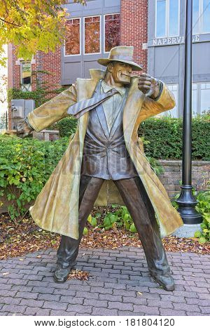 Naperville IL USA - October 7 2012: Statue of Dick Tracy Along the Riverwalk in Naperville Illinois