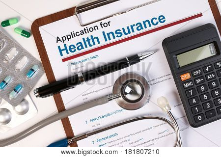 Application Form For Health Insurance, Paperwork, Questionnaire, Pen, Tablet, Calculator And Stethos