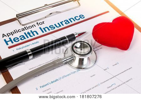 Application Form For Health Insurance, Paperwork, Questionnaire With Pen, Heart And Stethoscope. Hea