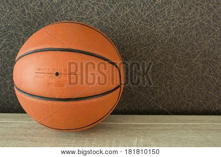 Close up of basketball on court floor