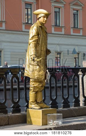 ST. PETERSBURG, RUSSIA - APRIL 10, 2017: Actor-mime in the image of a living statue on the embankment of the Griboedov Canal