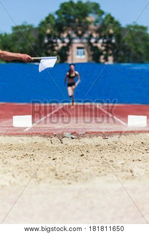 Athletic competition athlete accelerates for long jump