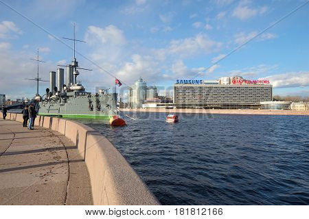 ST. PETERSBURG, RUSSIA - APRIL 08, 2017: A sunny April day on the Petrogradskaya embankment. View of the cruiser