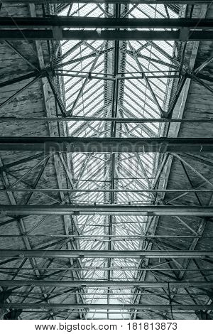 Roof Of Industrial Building. Ceiling Of Factory With Steel Beams.