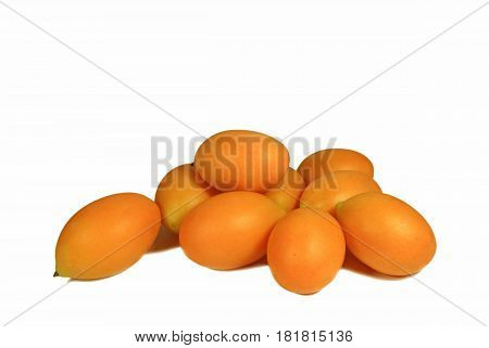 Heap of Vibrant Yellow Fresh Ripe Marian Plum or Ma-Prang Fruits Isolated on White Background