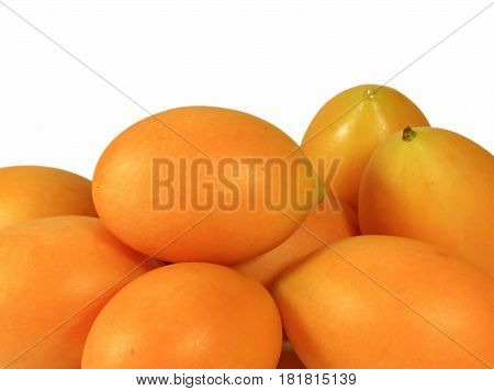 Heap of Vibrant Yellow Fresh Ripe Marian Plums Isolated on White Background