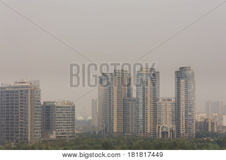 High angle horizontal building shot of sunset in beijing on a foggy day