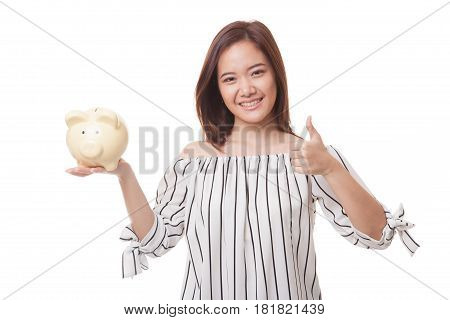 Asian Woman Thumbs Up With Pig Coin Bank.