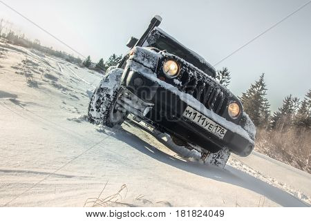 Leningrad region, Russia - April 14, 2017. Jeep Wrangler on the banks of protected rivers in the Leningrad region, Wrangler is a compact SUV produced by Chrysler