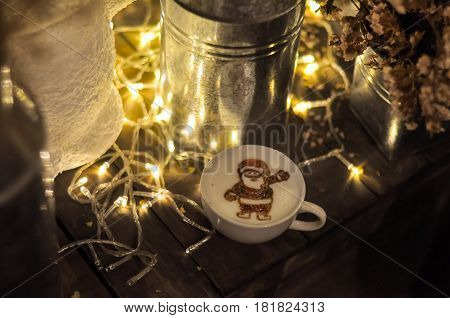 Santa Claus picture in latte art on wooden box in Christmas day