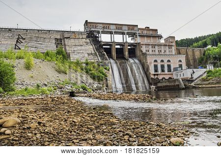 Dam Shirokovskaya hydroelectric power on a cloudy summer day. Russia Perm Krai Urals