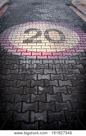 speed limit sign painted on the street