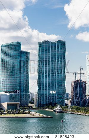 Two Condo Towers with Another Under Construction on Coast of Miami