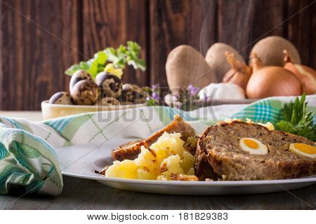 Portion Of Meatloaf On White Plate With Potatoes And Quail Eggs