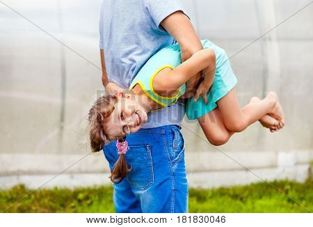 Cheerful Little Daughter play with Father outdoor