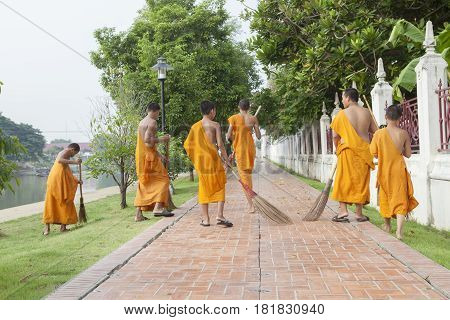 AYUTHAYA THAILAND - MARCH 28 : thai little monk morning daily cleaning in niwet thumaprawat temple on march 28 2015 in ayuthaya central of thailand