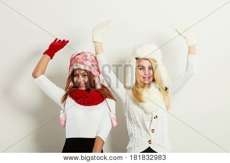 Two Girls Warm Winter Clothing Having Fun.
