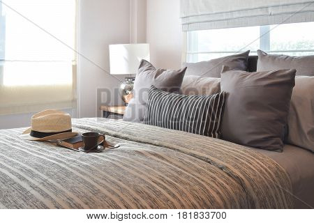Stylish Bedroom Interior Design With Striped Pillows On Bed And Decorative Table Lamp.