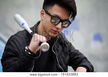 Asian young adult man on street posing at the camera