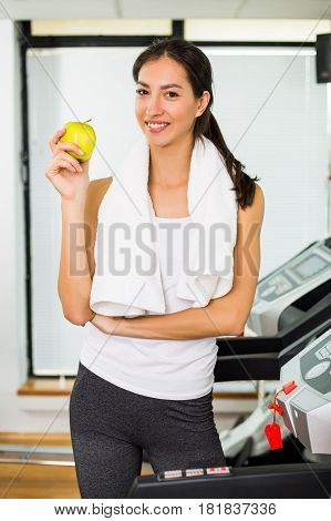 Fitness woman having healthy snack at the gym.