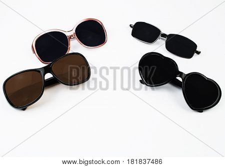 An assortment of sunglasses on a white isolated background