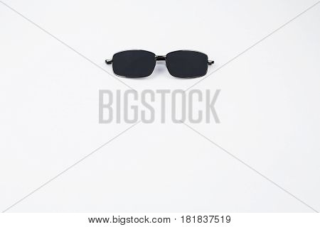 A pair of black sunglasses isolated on a white background