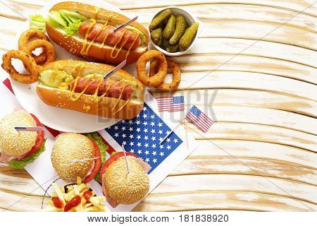 Traditional  hot dog, french fries and onion rings food for the celebration of July 4 - Independence Day of America