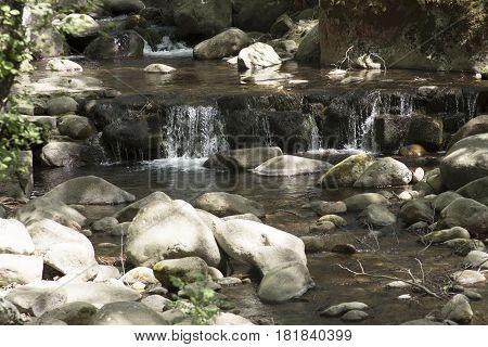 Waterfall on the route of the Serradilla, Piedralaves. Avila. Spain
