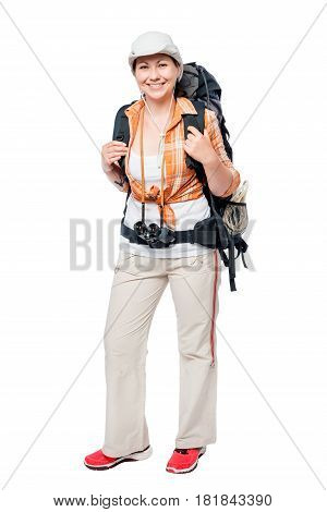 Girl With A Backpack Standing And Smiling On A White Background