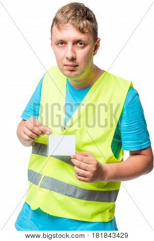 Worker In A Vest Shows His Badge On A White Background
