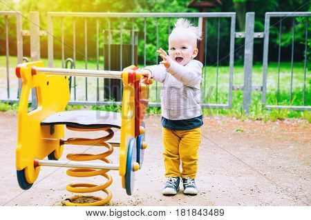 Little Boy Child Playing On A Playground.