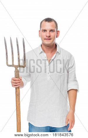 Vertical Portrait Of A Farmer With Forks In His Hand On A White Background