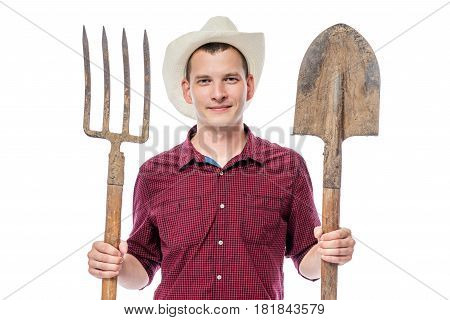 Farmer In Hat With Pitchforks And Shovel On White Background