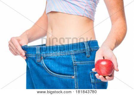 Focus On An Apple In A Slender Girl's Hand Against A Slender Body Background