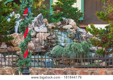 The decorated beautiful waterfall with Christmas ornamentations Helen USA
